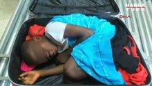 8 yaşındaki çocuğu bavulun içinde ülkeye sokmak istedi