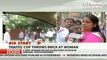 Trafik polisi rüşvet vermeyen kadın sürücüye tuğla fırlattı