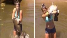 Elleriyle dev balığı yakalayan cesur kız