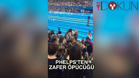 Michael Phelps'ten zafer öpücüğü
