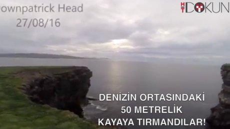 Deniz ortasındaki 50 metrelik kayaya tırmandı