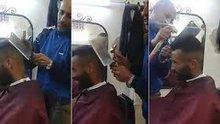 Saç tıraşını satırla yapan berber