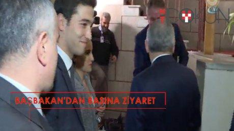 Başbakan'dan parlemento muhabirlerine ziyaret