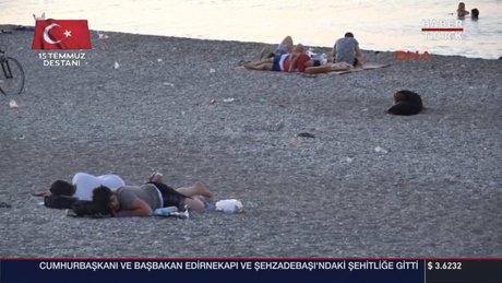 Antalya'da nemden bunalan sahilde sabahladı