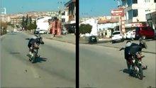 Bursa'da yatarak motosiklet kullanan genç trafiği tehlikeye attı