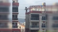 Metrelerce yükseklikte ölüme meydan okuyan işçiler