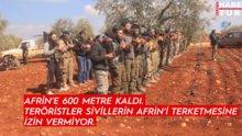 Afrin'e son 600 metre! Kenti terketmek isteyen siviller teröristlere direniyor