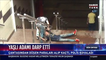 Yaşlı adamı Taksim'in ortasında hırpalayıp gasp etti!