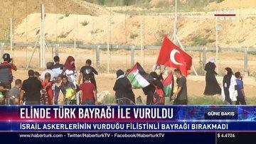 Elinde Türk bayrağı ile vuruldu