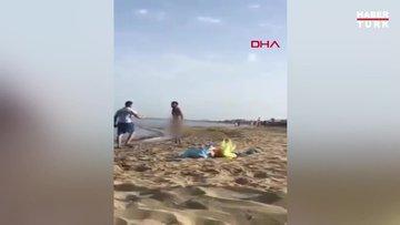 KKTC'de plajda çıplak gezen adama meydan dayağı