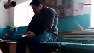 Rusya'da derse alkollü giren öğretmen masadan düştü, uyuya kaldı
