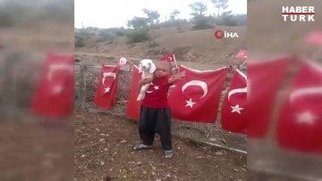 """Yörük çocuğu kucağında kuzusu, elinde bayrağı ile """"Astsubay olacağım, vatan toprağını koruyacağım"""""""