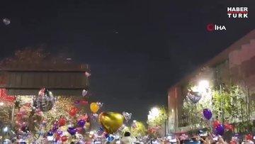 Covid-19'un ilk görüldüğü yer olan Wuhan'da binlerce kişi yeni yılı kutlamak için meydanlarda toplandı